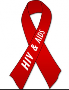 Фото. Красная ленточка - символ борьбы с ВИЧ/СПИДом.